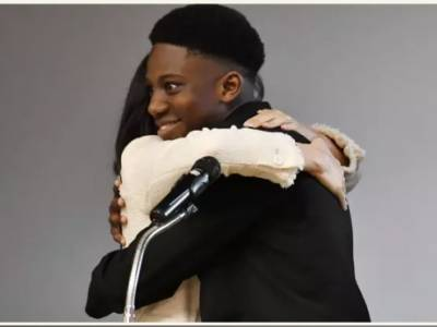 Nigerian Teen Can't Believe His Luck As He Gets A Kiss & Hug From Meghan Markle