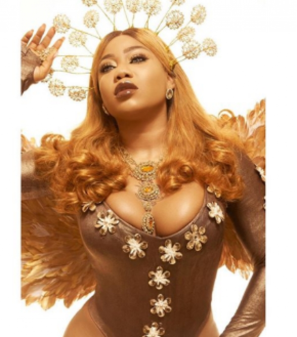 """It won't be well with your father. Bastard"" - Toyin Lawani slams follower"